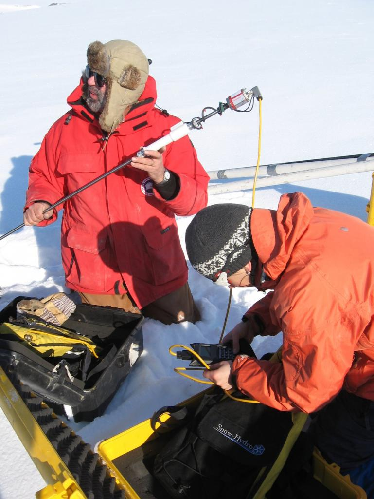 "Mark Serreze and Sveta Berezovskaya set up magna-probes during the 2009 SnowNet project. Image courtesy Andrew Slater, NSIDC. (<a href=""/cryosphere/gallery/photo/33655"">View photo detail.</a>) <br>"