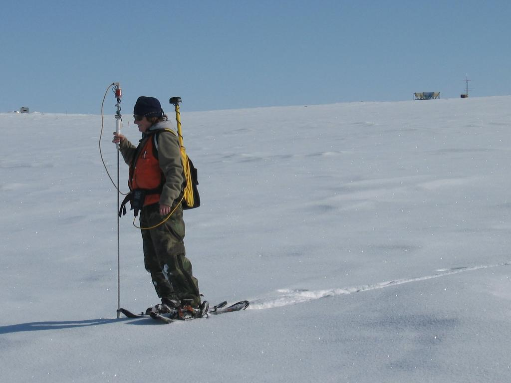 "Steph Saari from CRREL snowshoes with equipment. Image courtesy Andrew Slater, NSIDC. (<a href=""/cryosphere/gallery/photo/33654"">View photo detail.</a>) <br>"