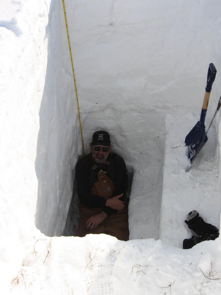 "Mark Serreze rests after finally reaching the bottom of a snow pit. Image courtesy Andrew Slater, NSIDC. (<a href=""/cryosphere/gallery/photo/33660"">View photo detail.</a>) <br>"