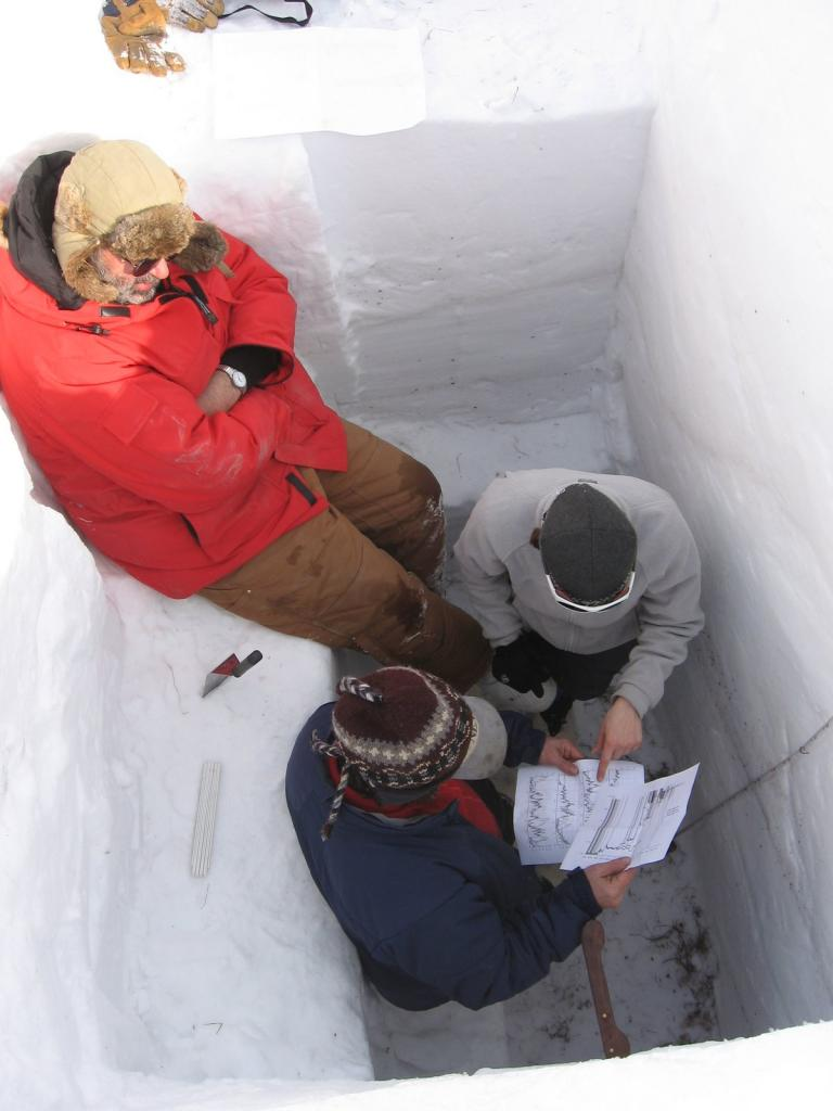 "Mark Serreze, Matthew Sturm, and another scientist look over some data. Image courtesy Andrew Slater, NSIDC. (<a href=""/cryosphere/gallery/photo/33663"">View photo detail.</a>) <br>"