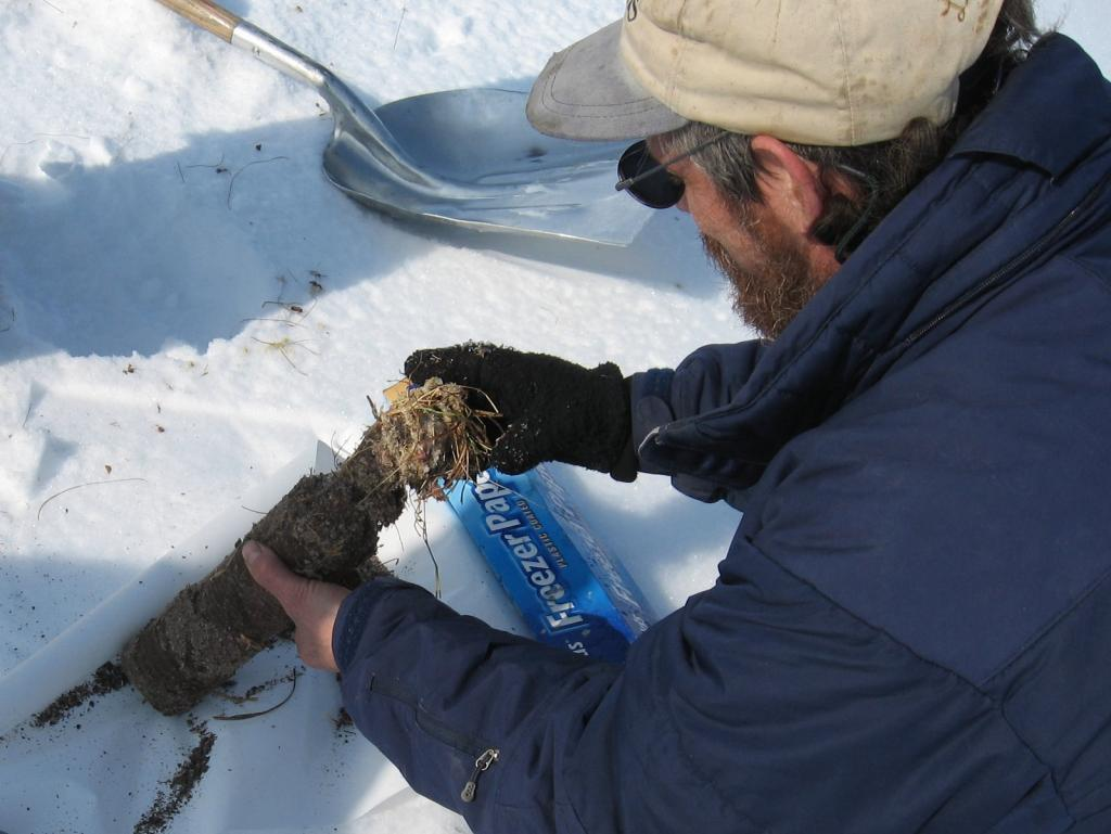 "Matthew Sturm examines a sample  during the 2009 SnowNet project. Image courtesy Andrew Slater, NSIDC. (<a href=""/cryosphere/gallery/photo/33667"">View photo detail.</a>) <br>"