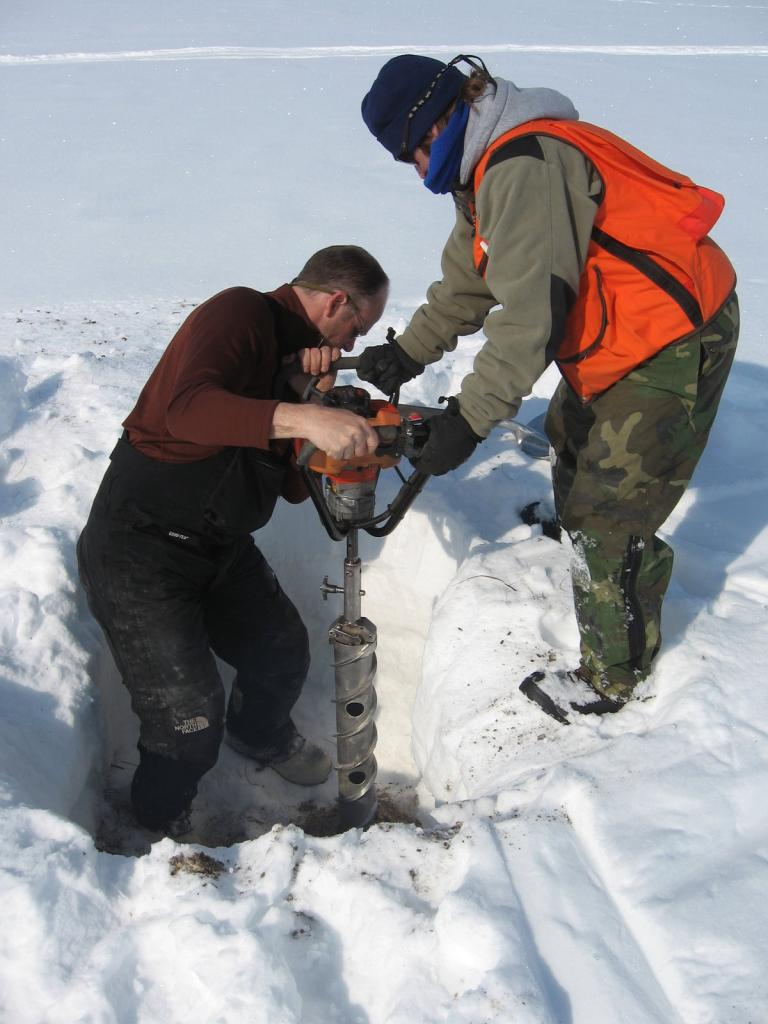 "Tom Douglas and Steph Saari work together to get a core sample. Image courtesy Andrew Slater, NSIDC. (<a href=""/cryosphere/gallery/photo/33664"">View photo detail.</a>) <br>"
