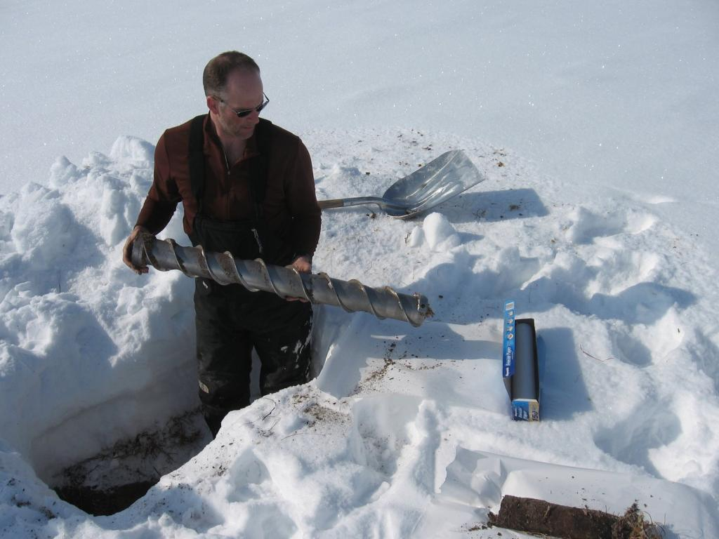 "Tom Douglas remove a core sample. Image courtesy Andrew Slater, NSIDC. (<a href=""/cryosphere/gallery/photo/33668"">View photo detail.</a>) <br>"