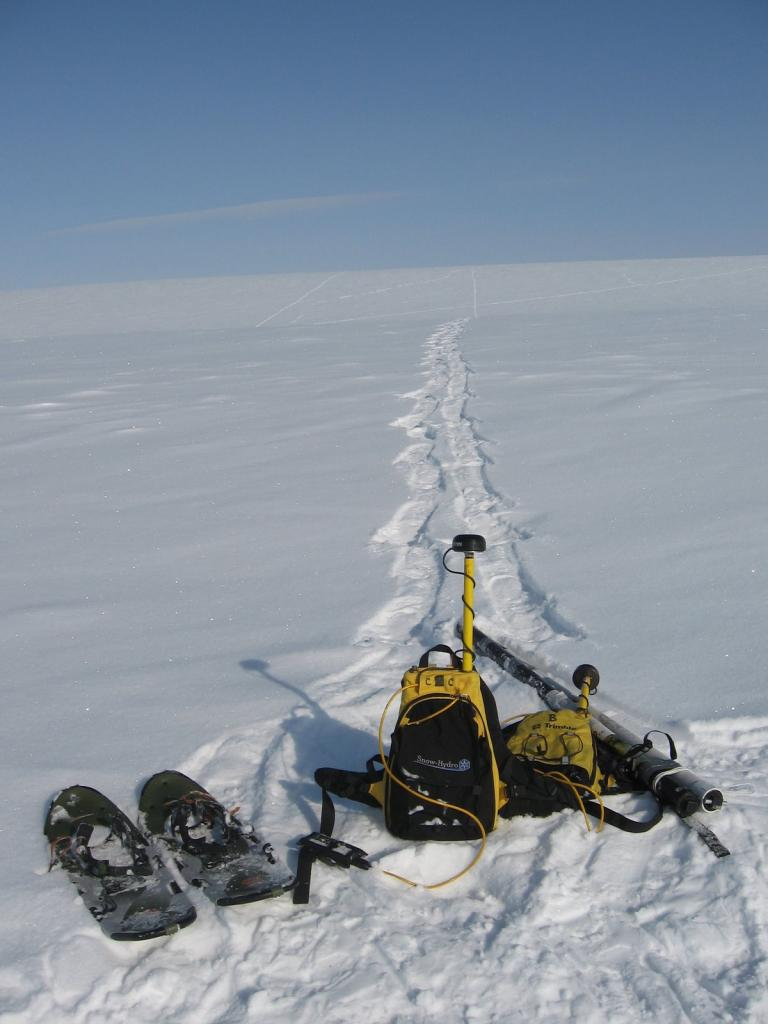 "Equipment lined up in front of a long magna-probe line. Image courtesy Andrew Slater, NSIDC. (<a href=""/cryosphere/gallery/photo/33670"">View photo detail.</a>) <br>"