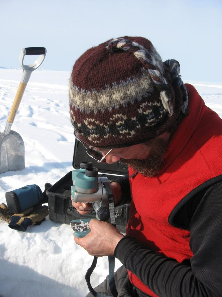 "Matthew Sturm examines a sample during the 2009 SnowNet project. Image courtesy  Andrew Slater, NSIDC. (<a href=""/cryosphere/gallery/photo/33674"">View photo detail.</a>) <br>"