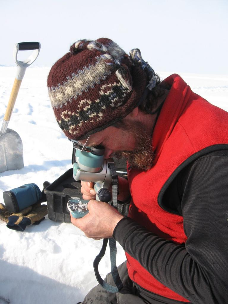 "Matthew Sturm examines a sample. Image courtesy Andrew Slater, NSIDC. (<a href=""/cryosphere/gallery/photo/33673"">View photo detail.</a>) <br>"