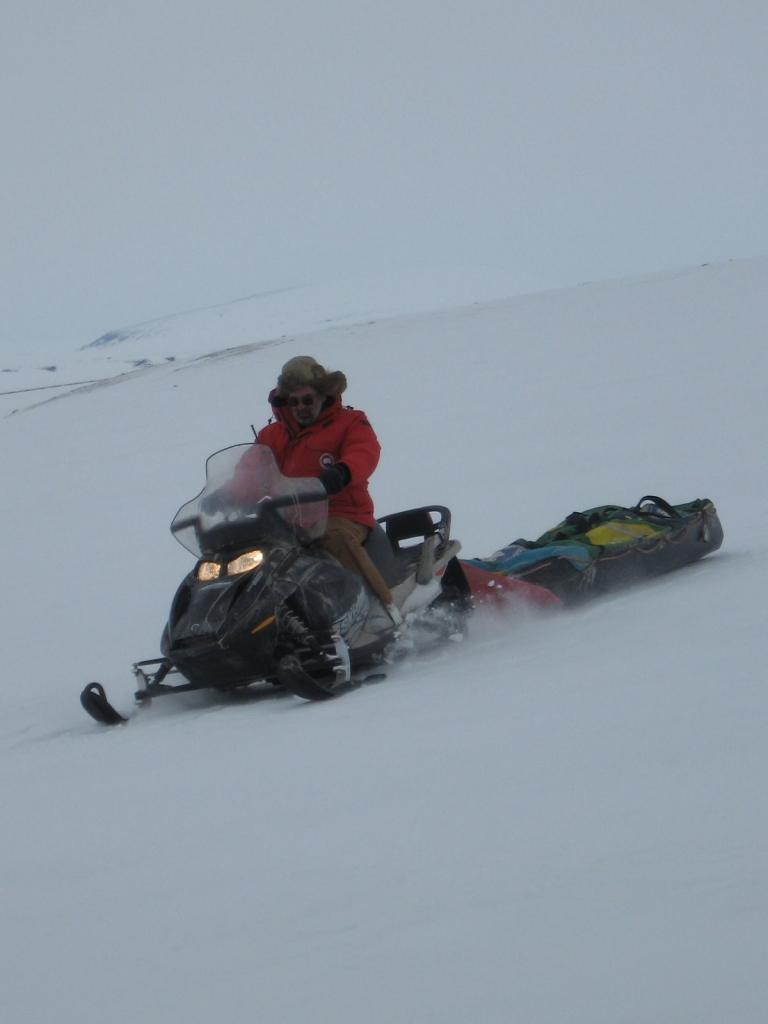 "Mark Serreze cruises on a snowmobile. Image courtesy  Andrew Slater, NSIDC. (<a href=""/cryosphere/gallery/photo/33686"">View photo detail.</a>) <br>"