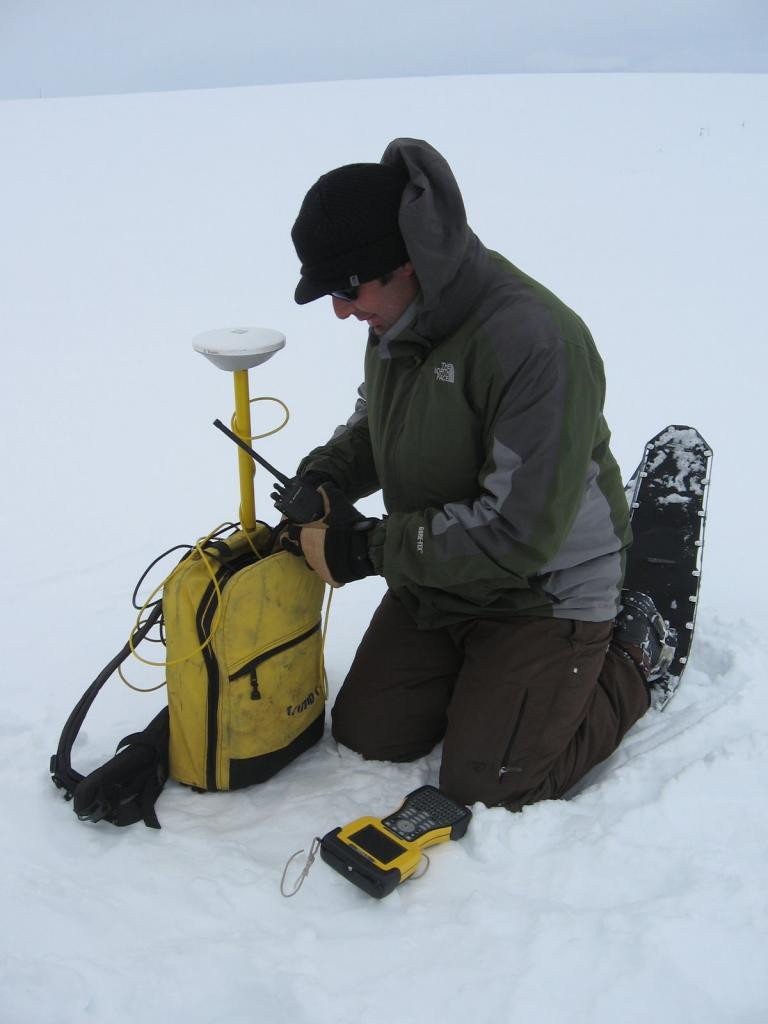 "Chris Hiemstra prepares to take a GPS measurement. Image courtesy  Andrew Slater, NSIDC. (<a href=""/cryosphere/gallery/photo/33689"">View photo detail.</a>) <br>"