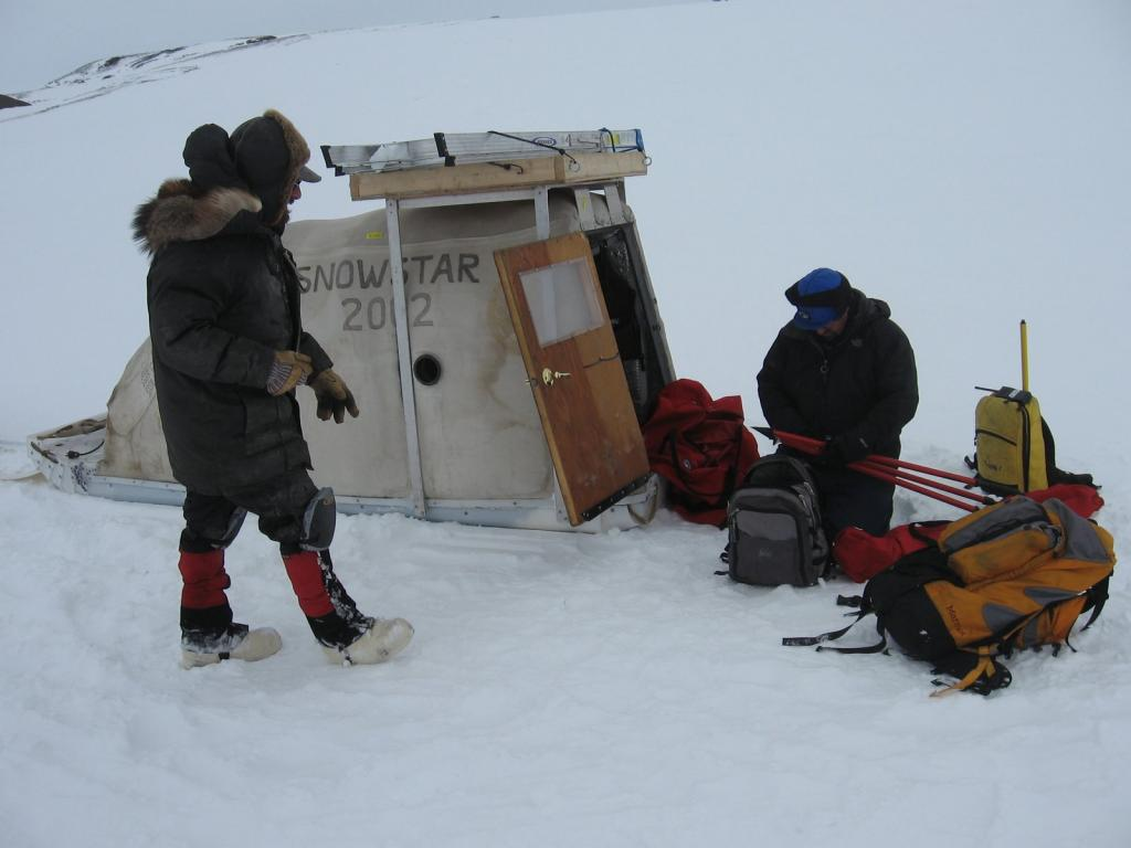 "Matthew Sturm and Art Gelvin remove equipment from the SnowStar. Image courtesy  Andrew Slater, NSIDC. (<a href=""/cryosphere/gallery/photo/33691"">View photo detail.</a>) <br>"