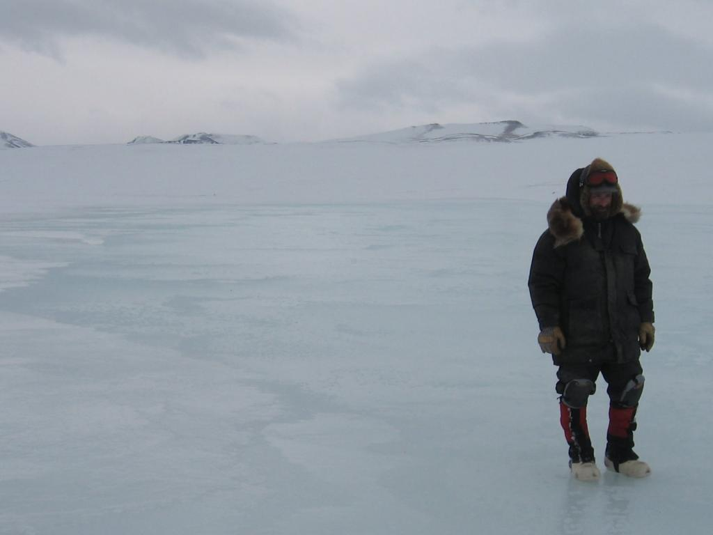 "Matthew Sturm poses on a frozen lake during the 2009 SnowNet project. Image courtesy Andrew Slater, NSIDC. (<a href=""/cryosphere/gallery/photo/33695"">View photo detail.</a>) <br>"