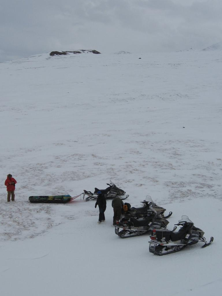"Scientists stand ready to ride away on snowmobiles. Image courtesy  Andrew Slater, NSIDC. (<a href=""/cryosphere/gallery/photo/33690"">View photo detail.</a>) <br>"