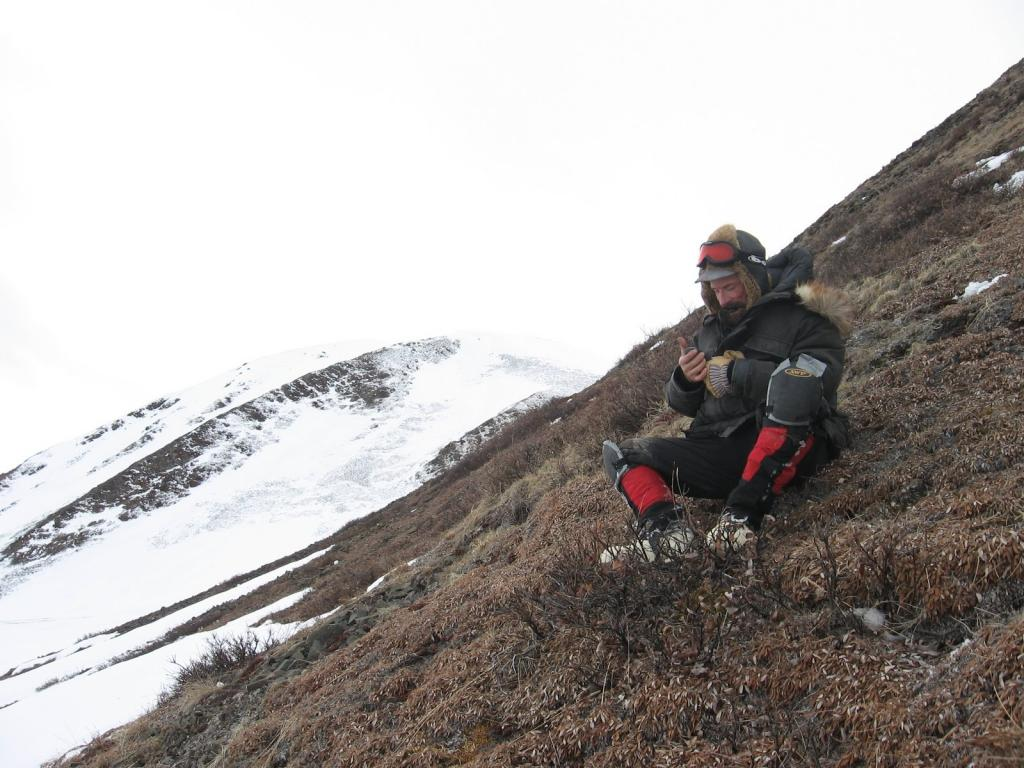 "Matthew Sturm hangs out on a hillside in Atigun Gorge. Image courtesy  Andrew Slater, NSIDC. (<a href=""/cryosphere/gallery/photo/33692"">View photo detail.</a>) <br>"