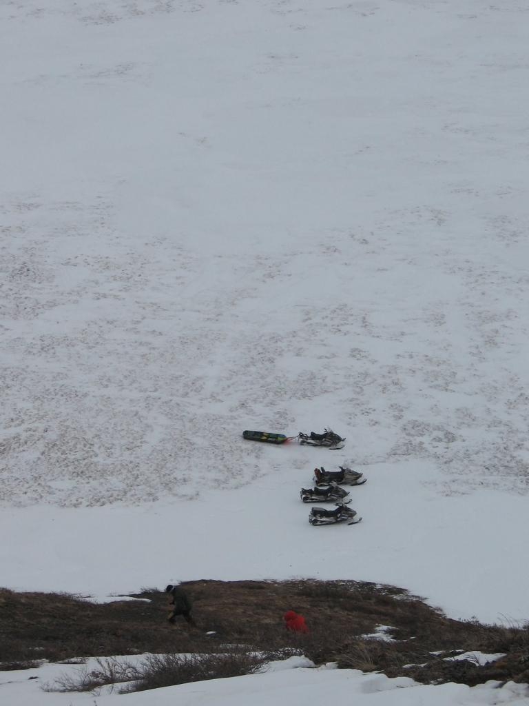 "Snowmobiles wait at the bottom of a hill. Image courtesy  Andrew Slater, NSIDC. (<a href=""/cryosphere/gallery/photo/33693"">View photo detail.</a>) <br>"