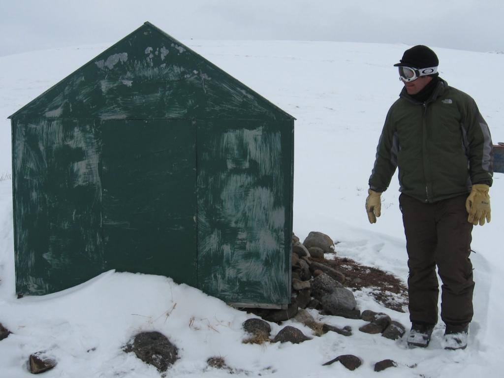 "Christopher Hiemstra checks out a shed. Image courtesy Andrew Slater, NSIDC. (<a href=""/cryosphere/gallery/photo/33706"">View photo detail.</a>) <br>"