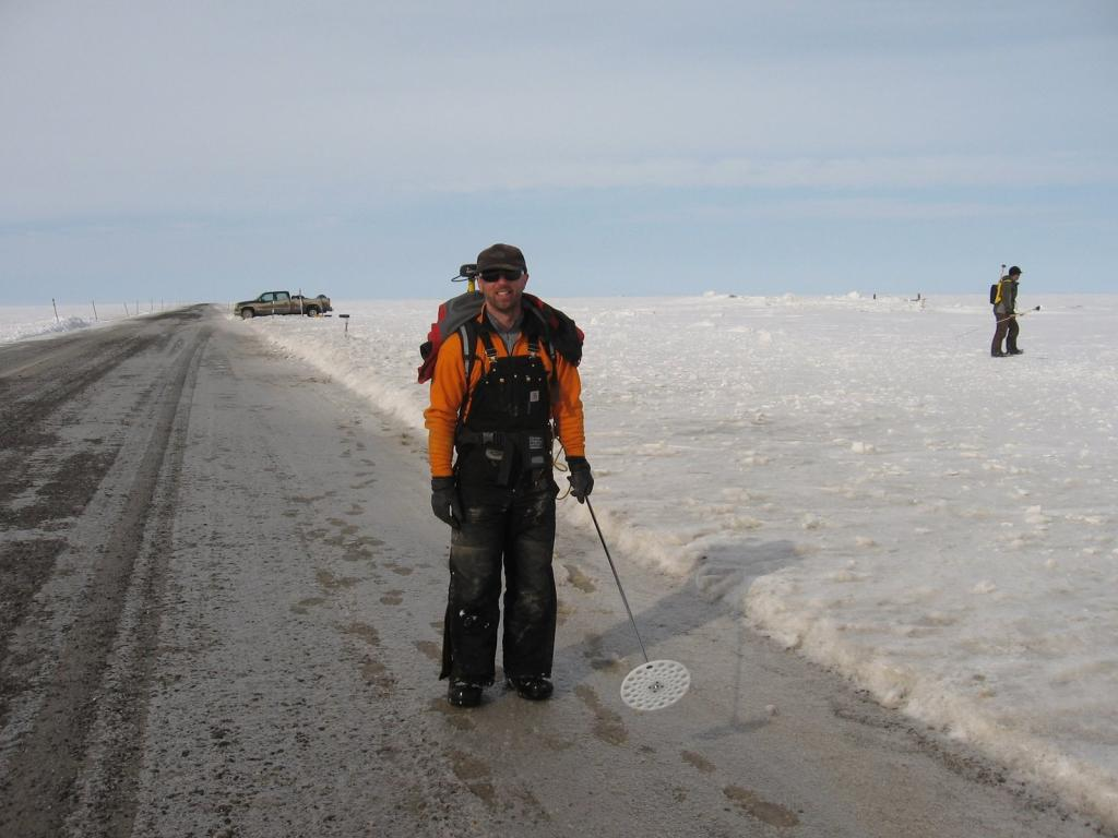 "Drew Slater gets ready to conduct magna-probe measurements. Image courtesy Andrew Slater, NSIDC. (<a href=""/cryosphere/gallery/photo/33716"">View photo detail.</a>) <br>"