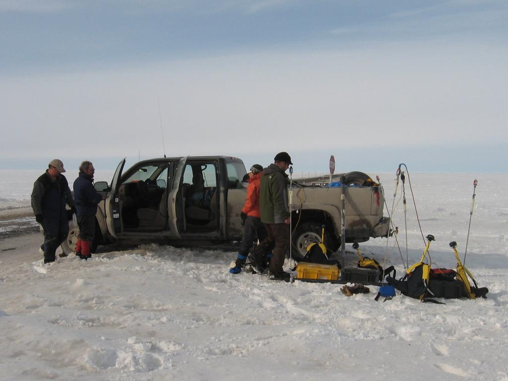 "Scientists pack up the gear for the night. From left to right: Art Gelvin, Matthew Sturm, Sveta Berezovskaya, and Christopher Hiemstra Image courtesy Andrew Slater, NSIDC. (<a href=""/cryosphere/gallery/photo/33717"">View photo detail.</a>) <br>"