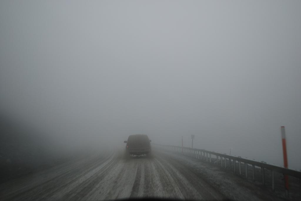 "Driving the Dalton Highway on August 15, 2012 becomes difficult as visibility drops to zero on Atigun Pass in the Brooks Range, Alaska. (Credit: Kevin Schaefer, NSIDC) (<a href=""/cryosphere/gallery/photo/34172"">View photo detail.</a>) <br>"