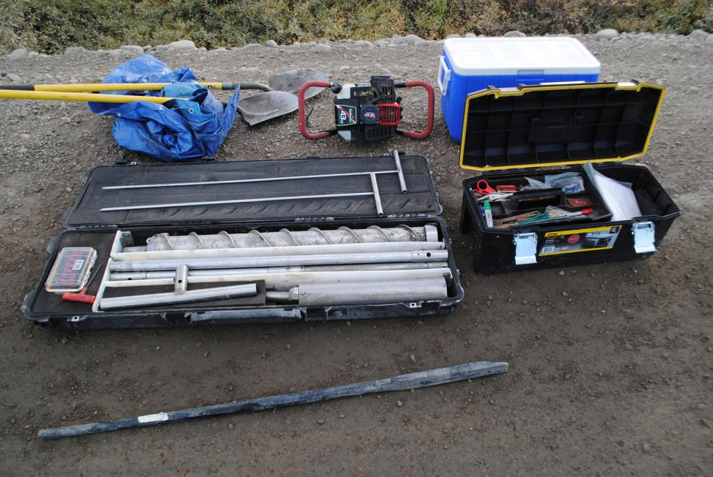 "The equipment required to drill permafrost cores consists of shovels and a tarp, a motor to power the drill, a cooler to keep the samples frozen, a toolbox, a steel pry bar, and an augur drill bit. (Credit: Kevin Schaefer, NSIDC) (<a href=""/cryosphere/gallery/photo/34173"">View photo detail.</a>) <br>"