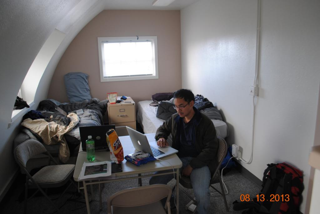 "Lin Liu checks the day's data at basecamp. (Credit: Kevin Schaefer, NSIDC) (<a href=""/cryosphere/gallery/photo/34165"">View photo detail.</a>) <br>"