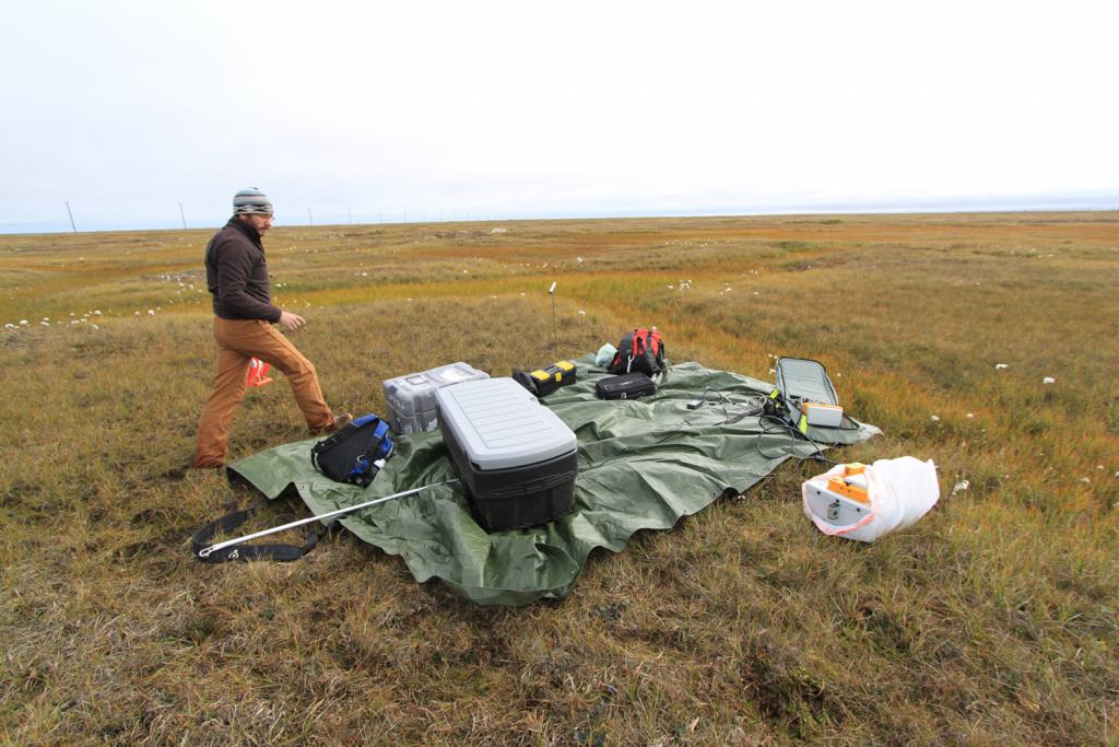 "Andy Parsekian sets up the ground penetrating radar equipment for a survey of active layer depth near Barrow, Alaska on August 13, 2013. (Credit: Lin Liu). (<a href=""/cryosphere/gallery/photo/34164"">View photo detail.</a>) <br>"