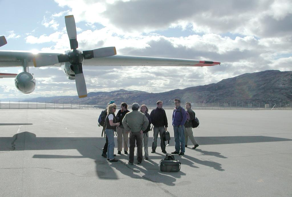 "We land in Kangerlussuaq, Greenland. The people standing in this photo are the other civilians (scientists and journalists) who were on the flight with me.Photo by John Maurer, CIRES/NSIDC, University of Colorado. (<a href=""/cryosphere/gallery/photo/33110"">View photo detail.</a>) <br>"
