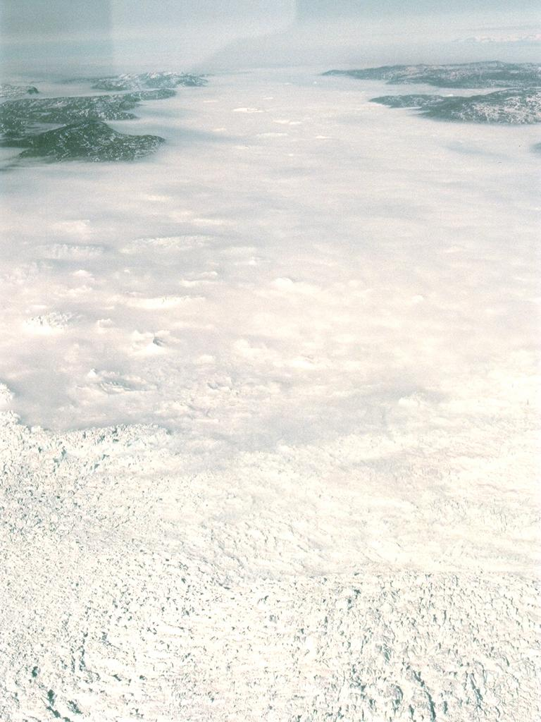 "View from the twin otter out onto the ice sheet: clouds blanket the surface. Photo by John Maurer, CIRES/NSIDC, University of Colorado. (<a href=""/cryosphere/gallery/photo/33130"">View photo detail.</a>) <br>"