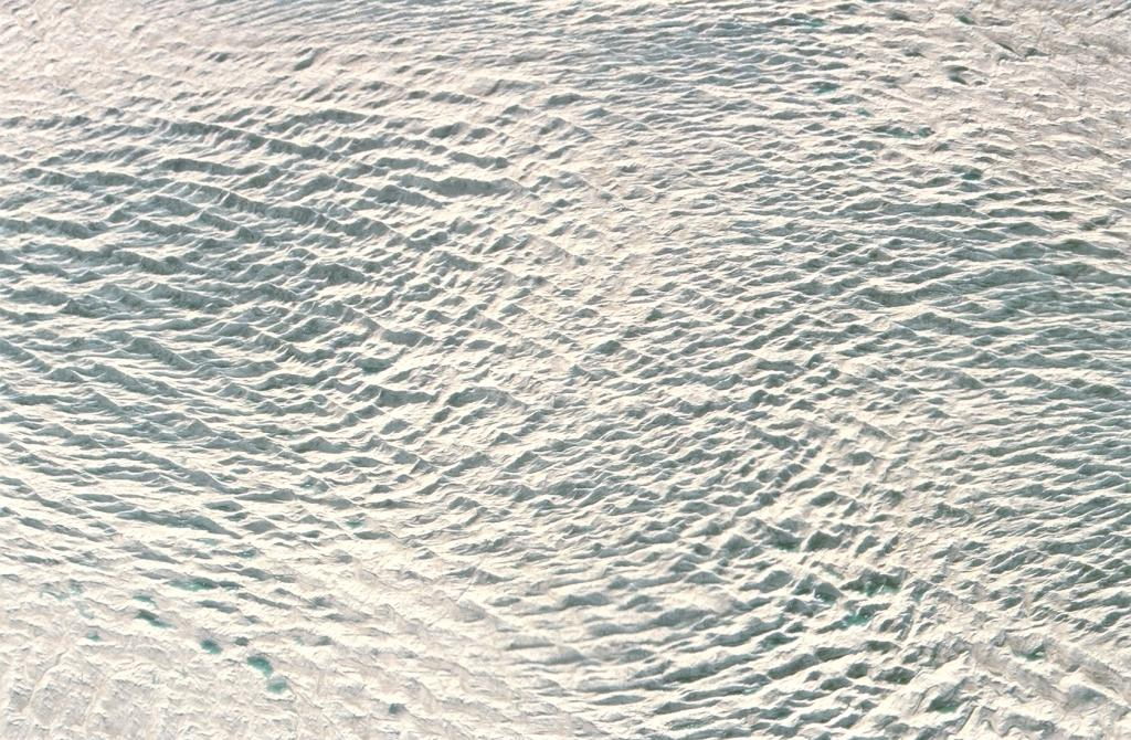 "Large patterns in the ice near Jakobshavn glacier, viewed from the twin otter. Photo by John Maurer, CIRES/NSIDC, University of Colorado. (<a href=""/cryosphere/gallery/photo/33133"">View photo detail.</a>) <br>"