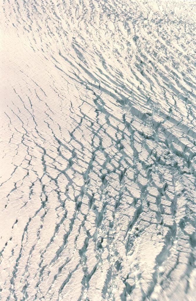 "Large crevasses in the ice near Jakobshavn glacier, viewed from the twin otter. Photo by John Maurer, CIRES/NSIDC, University of Colorado. (<a href=""/cryosphere/gallery/photo/32974"">View photo detail.</a>) <br>"