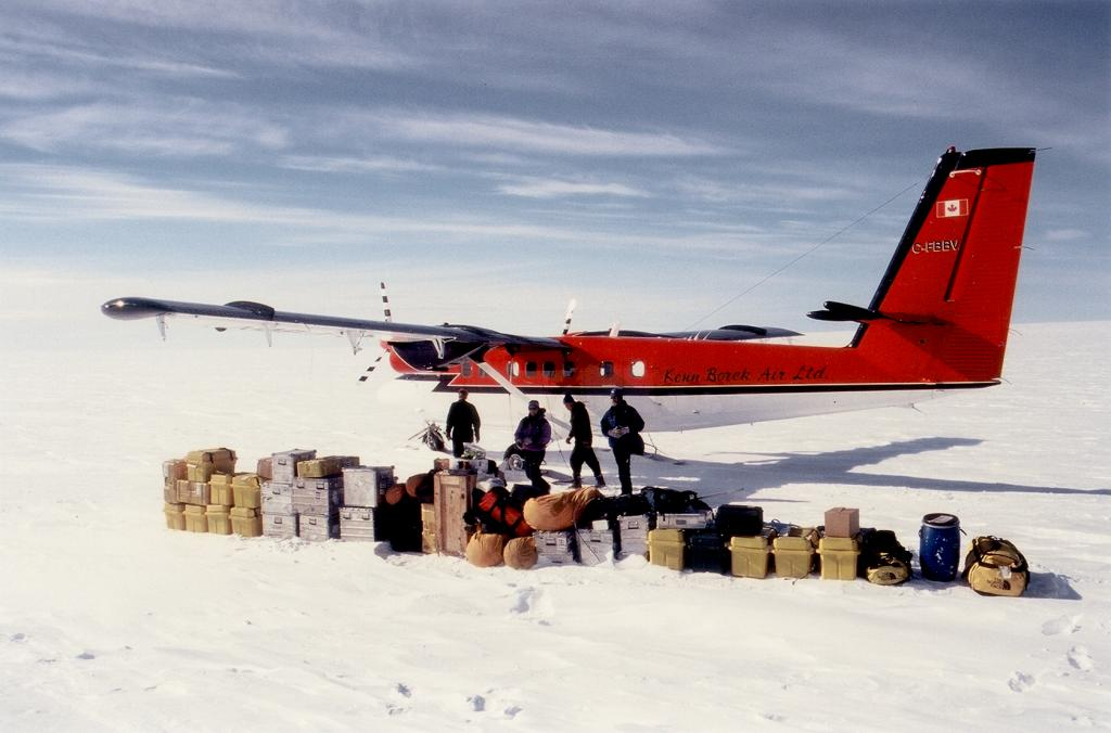 "We land at Swiss Camp and line up all our cargo: can you believe that all fit in the plane?? The yellow boxes are filled with food. The silver boxes are filled with instruments, tools, and wires. The bags are our personal gear. Photo by John Maurer, CIRES/NSIDC, University of Colorado. (<a href=""/cryosphere/gallery/photo/33134"">View photo detail.</a>) <br>"