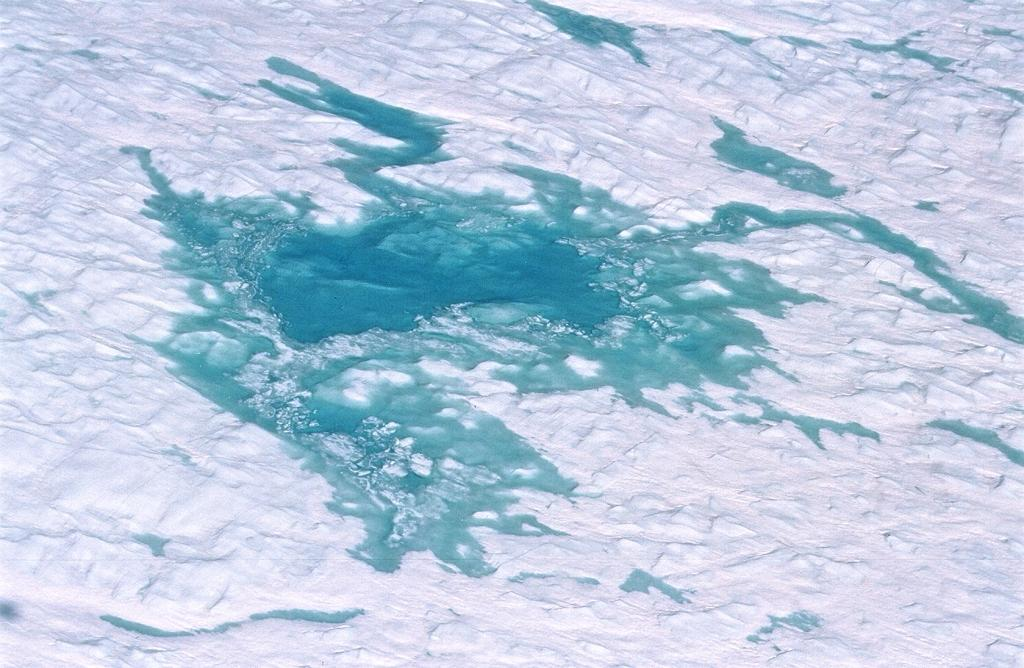 "A close-up shot from the helicopter of one of the huge melt lakes. Photo by John Maurer, CIRES/NSIDC, University of Colorado. (<a href=""/cryosphere/gallery/photo/33144"">View photo detail.</a>) <br>"