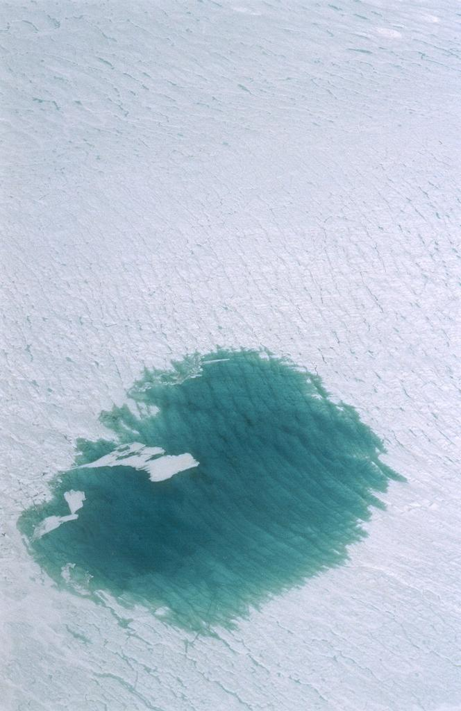 "A close-up shot from the helicopter of another huge melt lake. Photo by John Maurer, CIRES/NSIDC, University of Colorado. (<a href=""/cryosphere/gallery/photo/33147"">View photo detail.</a>) <br>"