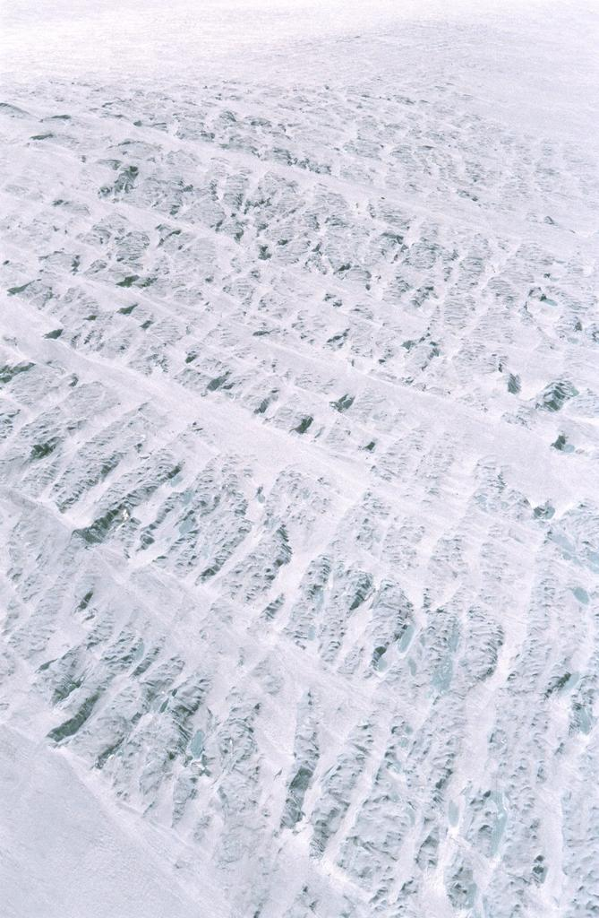 "View from the helicopter at patterns in the ice sheet and blue melt ponds, near the coast by Jakobshavn glacier. Photo by John Maurer, CIRES/NSIDC, University of Colorado. (<a href=""/cryosphere/gallery/photo/33145"">View photo detail.</a>) <br>"