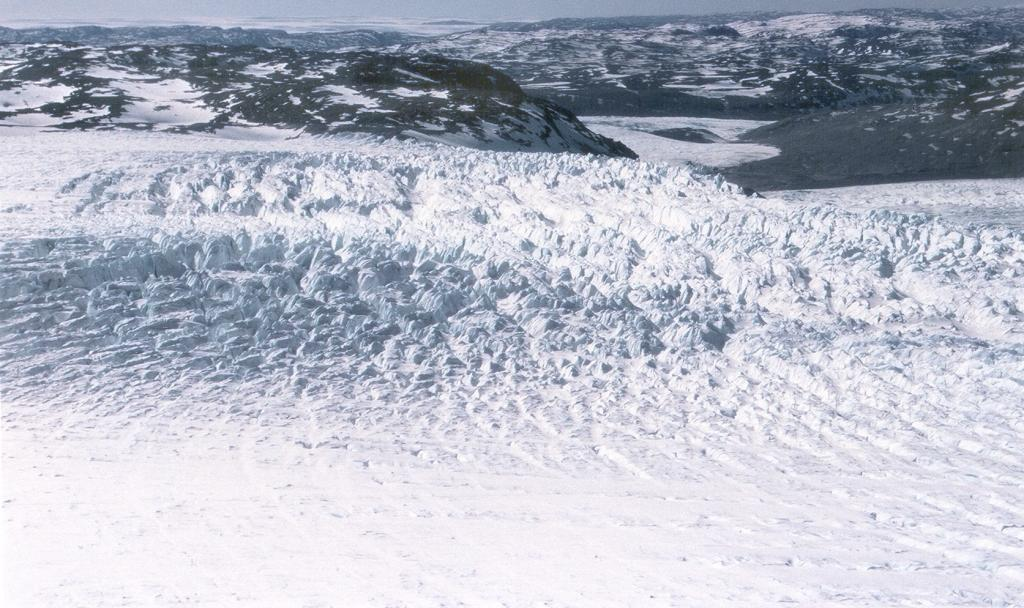 "View from the helicopter near the coast by Jakobshavn glacier, where the ice becomes very choppy. Photo by John Maurer, CIRES/NSIDC, University of Colorado. (<a href=""/cryosphere/gallery/photo/33146"">View photo detail.</a>) <br>"