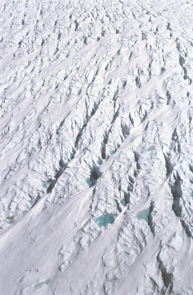 "View from the helicopter near the coast by Jakobshavn glacier, where the ice becomes very choppy. Photo by John Maurer, CIRES/NSIDC, University of Colorado. (<a href=""/cryosphere/gallery/photo/33150"">View photo detail.</a>) <br>"