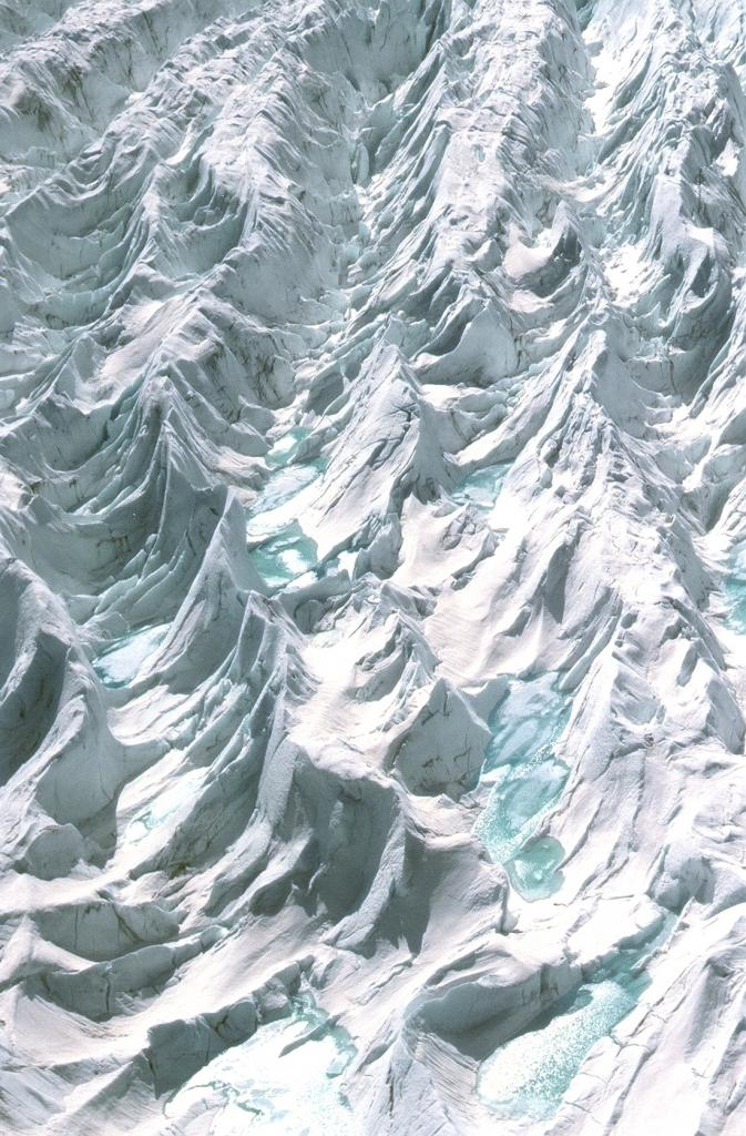 "A close-up from the helicopter of the choppy ice near the coast by Jakobshavn glacier. These patterns were almost as deep as a one-story house, I would guess. Photo by John Maurer, CIRES/NSIDC, University of Colorado. (<a href=""/cryosphere/gallery/photo/33151"">View photo detail.</a>) <br>"
