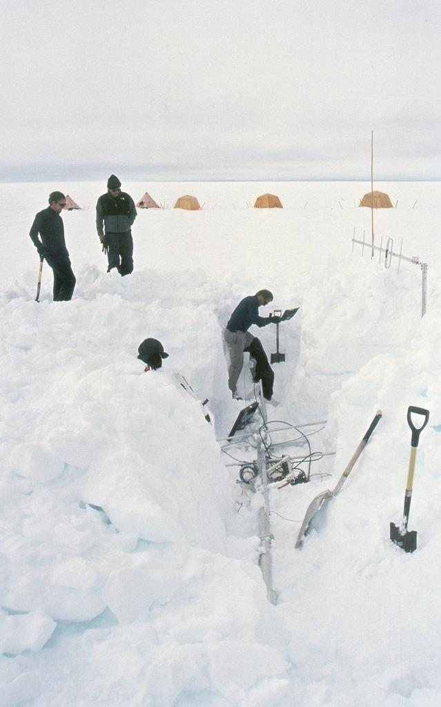 "The weather station outside of Swiss Camp had been toppled over by the wind during the winter and was buried a couple of meters under the snow. Photo by John Maurer, CIRES/NSIDC, University of Colorado. (<a href=""/cryosphere/gallery/photo/33161"">View photo detail.</a>) <br>"