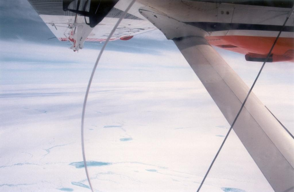 "View from the plane (another 'twin otter') down onto the ice sheet during our flight south. Photo by John Maurer, CIRES/NSIDC, University of Colorado. (<a href=""/cryosphere/gallery/photo/33173"">View photo detail.</a>) <br>"