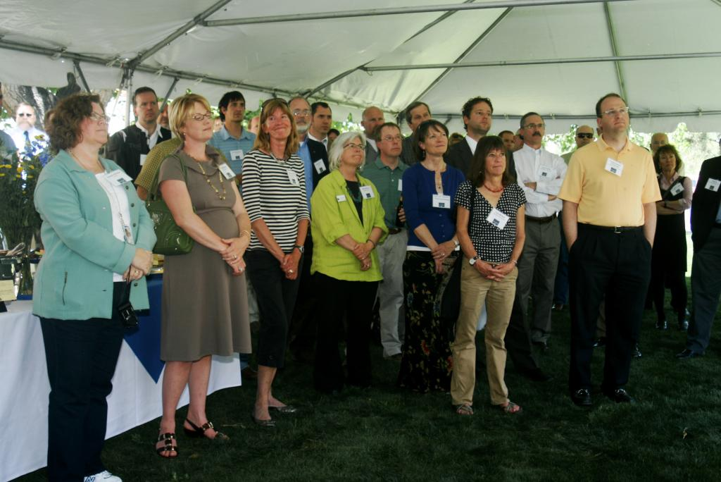 "University and community leaders celebrate the Green Data Center with NSIDC staff on May 4, 2012 in Boulder. Colorado. First row, left to right: Jeanne Behnke, Science Operations Manager at NASA's Earth Science Data and Information System; Emily Jasiak, Louisville City Council; Lesley Smith, outreach staff at the Cooperative Institute for Research in Environmental Sciences (CIRES); Deb Gardner, Boulder County Commissioner; Frances Draper, University of Colorado Vice Chancellor for Strategic Relations; Lisa Morzel, Boulder City Council; and U.S. Representative Jared Polis. —Credit: Natasha Vizcarra/NSIDC (<a href=""/cryosphere/gallery/photo/34020"">View photo detail.</a>) <br>"