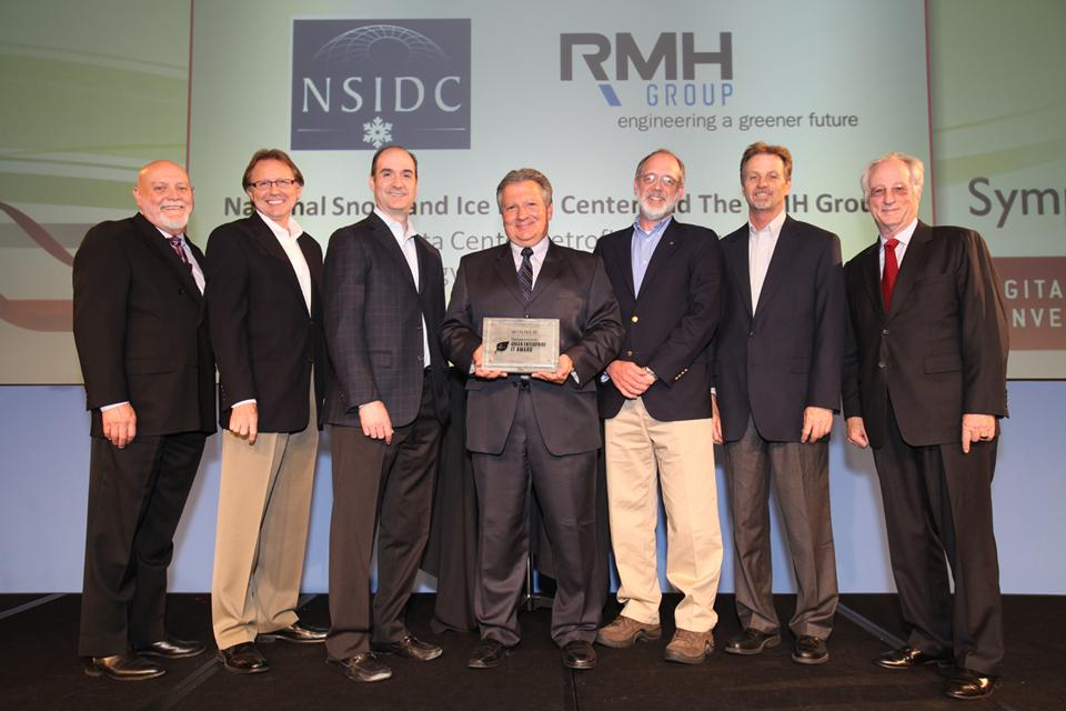 "Ronald Weaver (fifth from left) accepts an award for the National Snow and Ice Data Center (NSIDC) with representatives of the RMH Group, an engineering consulting firm, on May 14, 2012 in Santa Clara, California. The Uptime Institute conferred the two organizations with the 2012 Green Enterprise IT (GEIT) Award for the Green Data Center project, an on-budget retrofit project which reduced the data center's energy use by 90 percent. Weaver is Principal Investigator and Manager of the NASA Distributed Active Archive Center (DAAC) at NSIDC. --Credit: Uptime Institute (<a href=""/cryosphere/gallery/photo/34030"">View photo detail.</a>) <br>"