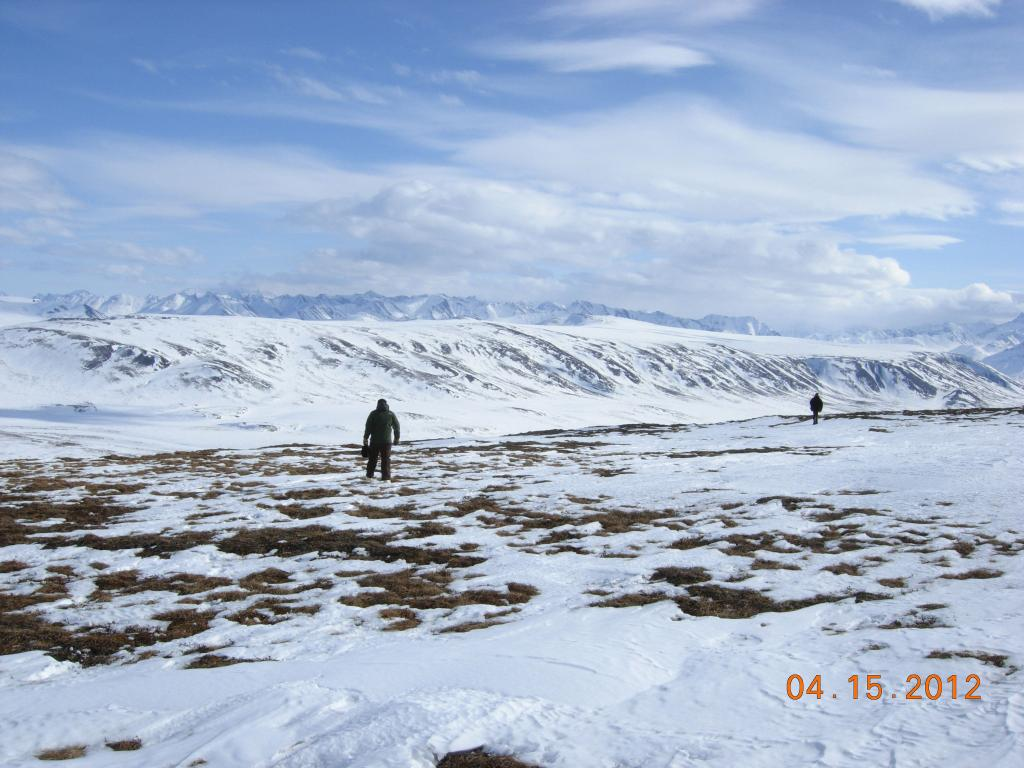 "Kelley Elder of the U.S. Forest Service takes snow samples on the tundra near the Brooks mountain range during the 2012 SnowNet expedition. --Credit: NSIDC, Mark Serreze (<a href=""/cryosphere/gallery/photo/34036"">View photo detail.</a>) <br>"