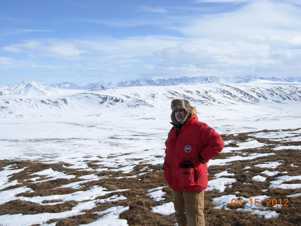 "NSIDC's Mark Serreze on the tundra near the Brooks mountain range during the 2012 SnowNet expedition. --Credit: NSIDC, Mark Serreze (<a href=""/cryosphere/gallery/photo/34031"">View photo detail.</a>) <br>"