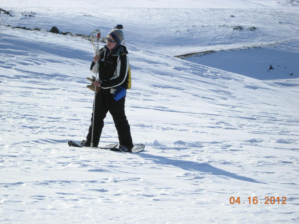 "NSIDC graduate student Allison Hurley sampling snow depth on the northern slope of Alaska during the 2012 SnowNet expedition. --Credit: NSIDC, Mark Serreze (<a href=""/cryosphere/gallery/photo/34035"">View photo detail.</a>) <br>"