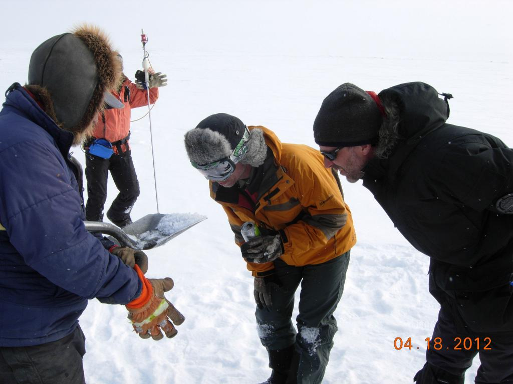"NSIDC Drew Slater and team examining snow crystals on the northern slope of Alaska during the 2012 SnowNet expedition. --Credit: NSIDC, Mark Serreze (<a href=""/cryosphere/gallery/photo/34041"">View photo detail.</a>) <br>"