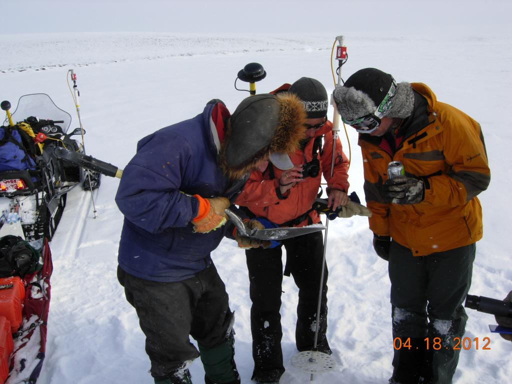 "CRREL's Matt Sturm and team examining snow crystals on the northern slope of Alaska during the 2012 SnowNet expedition. --Credit: NSIDC, Mark Serreze (<a href=""/cryosphere/gallery/photo/34038"">View photo detail.</a>) <br>"