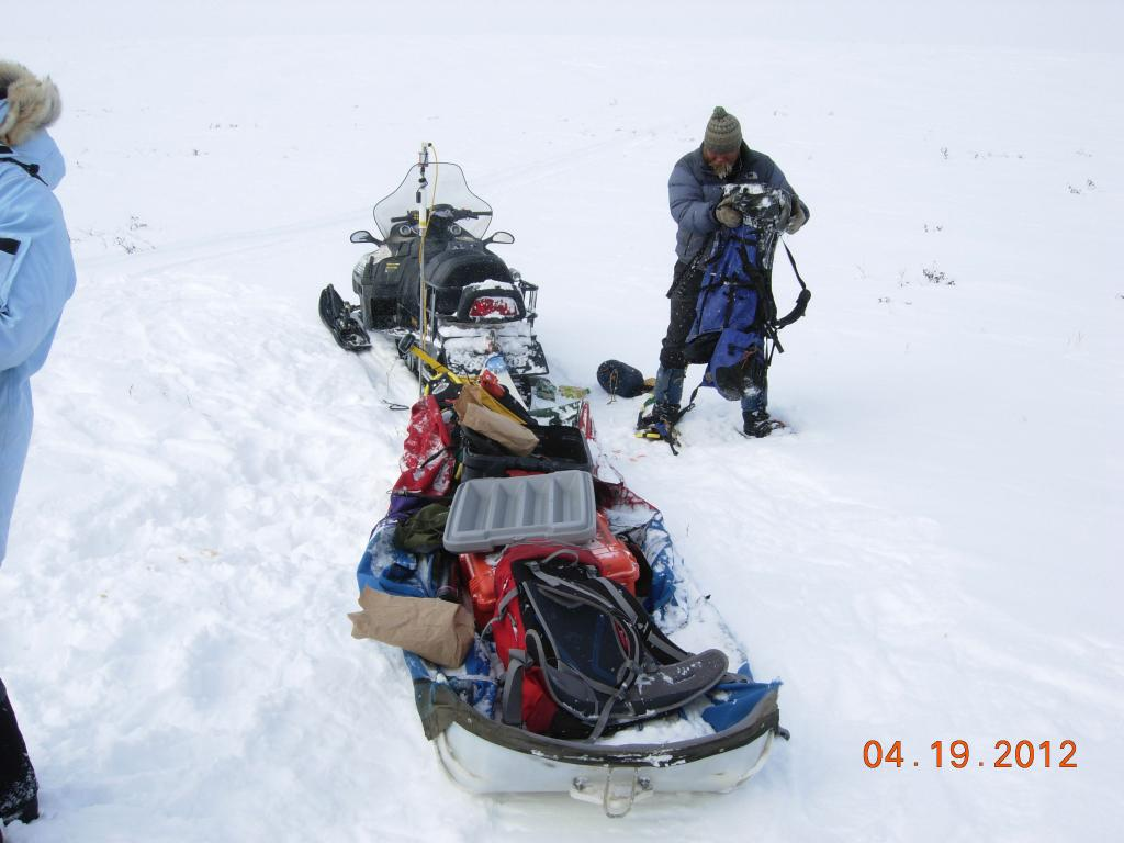"Kelley Elder of the U.S. Forest Service with a fully loaded sled of equipment on the northern slope of Alaska during the 2012 SnowNet expedition. --Credit: NSIDC, Mark Serreze (<a href=""/cryosphere/gallery/photo/34039"">View photo detail.</a>) <br>"