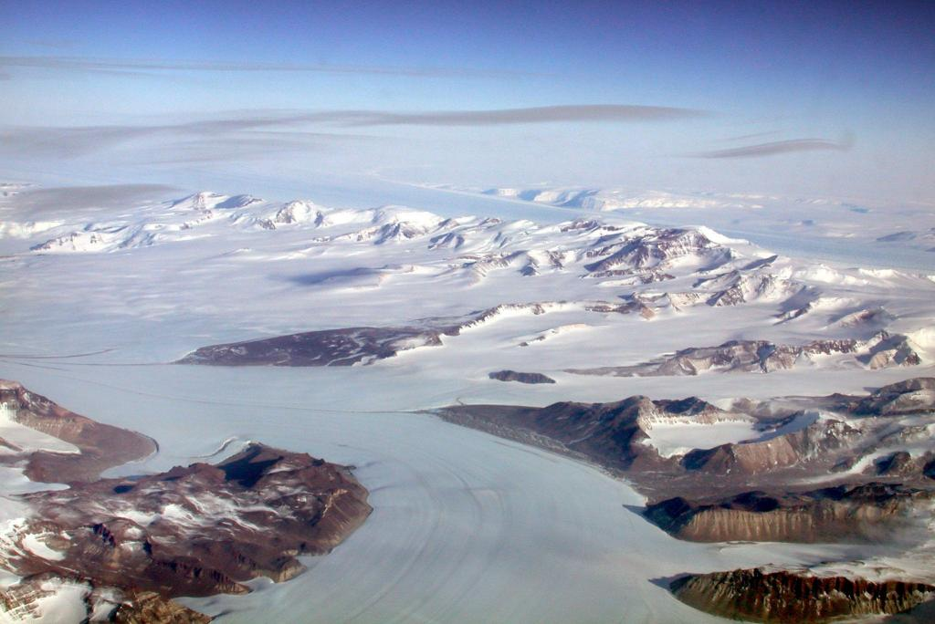 "This photo was taken during a flight over the Antarctic Ice Sheet. Bird Glacier lurks in the background, with Darwin Glacier in the foreground. Image Credit:  Courtesy Ted Scambos and Rob Bauer, NSIDC  <a href=""http://nsidc.org/antarctica/megadunes/"">Megadunes Web site</a> (<a href=""/cryosphere/gallery/photo/32959"">View photo detail.</a>) <br>"