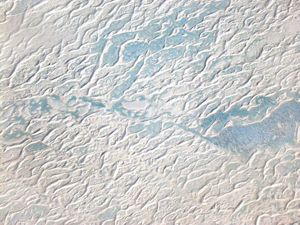 "This in-flight view of a blue ice region in Antarctica was taken during the 2002-03 Megadunes expedition. Image Credit:  Courtesy Ted Scambos and Rob Bauer, NSIDC  <a href=""http://nsidc.org/antarctica/megadunes/"">Megadunes Web site</a> (<a href=""/cryosphere/gallery/photo/32961"">View photo detail.</a>) <br>"