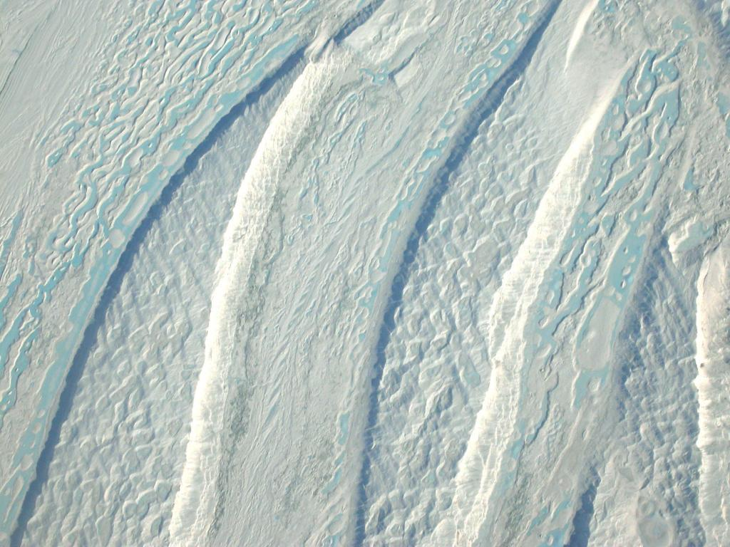"This in-flight view of a blue ice region in Antarctica was taken during the 2002-03 Megadunes expedition. Image Credit:  Courtesy Ted Scambos and Rob Bauer, NSIDC  <a href=""http://nsidc.org/antarctica/megadunes/"">Megadunes Web site</a> (<a href=""/cryosphere/gallery/photo/32963"">View photo detail.</a>) <br>"