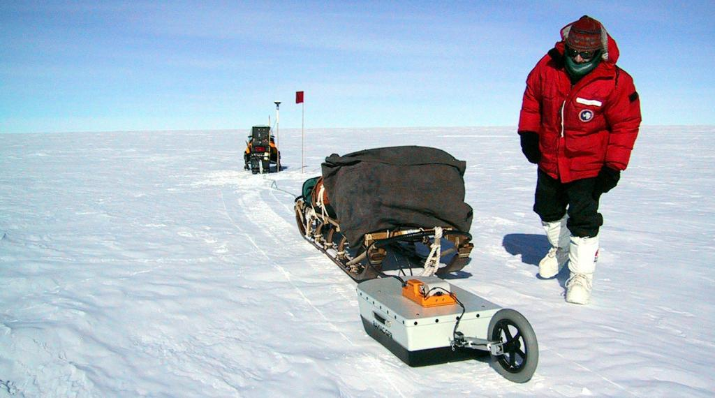 "Ted Scambos checks on the GPS/GPR surveying system during the 2002-03 Megadunes expedition. Image Credit:  Courtesy Ted Scambos and Rob Bauer, NSIDC  <a href=""http://nsidc.org/antarctica/megadunes/"">Megadunes Web site</a> (<a href=""/cryosphere/gallery/photo/32960"">View photo detail.</a>) <br>"