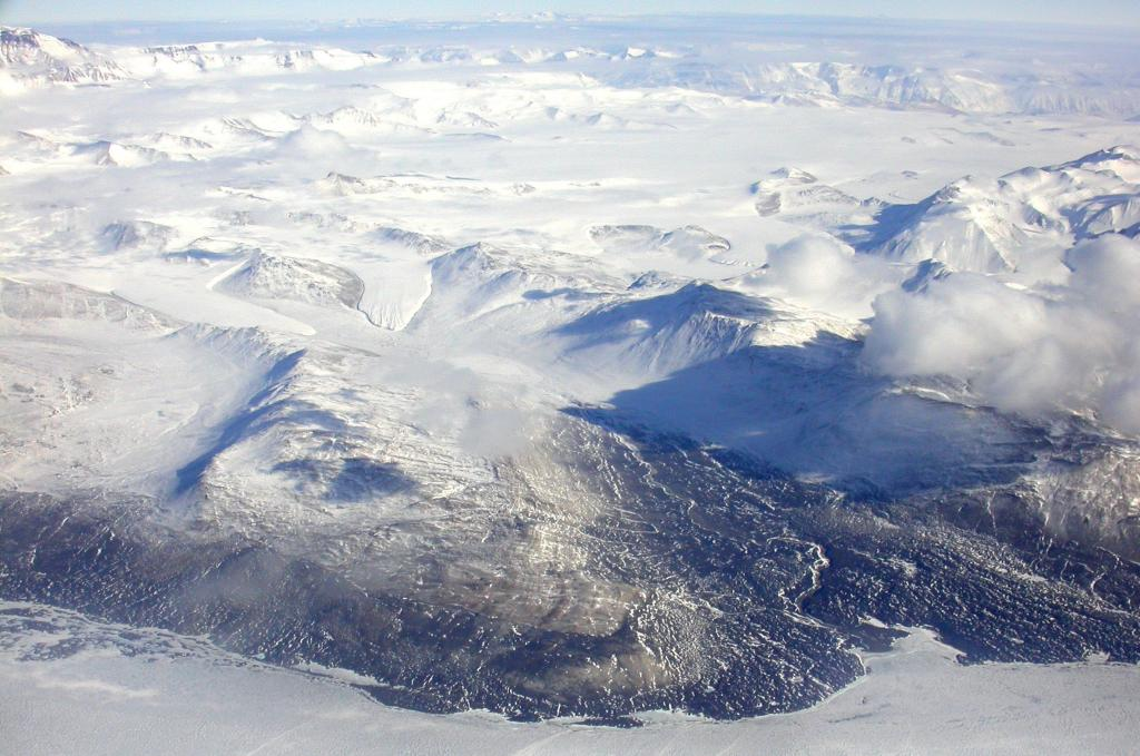 "Mountains rise over the Dry Valleys region in Antarctica. Image Credit:  Courtesy Ted Scambos and Rob Bauer, NSIDC  <a href=""http://nsidc.org/antarctica/megadunes/"">Megadunes Web site</a> (<a href=""/cryosphere/gallery/photo/32968"">View photo detail.</a>) <br>"
